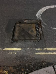 Pothole around manhole cover
